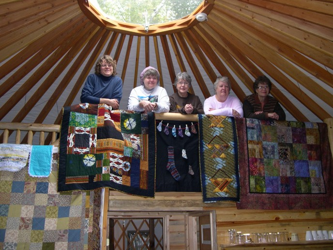 Group at the yurt railing[1]